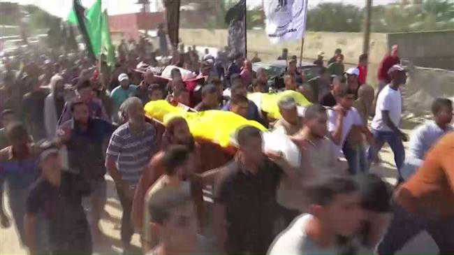 Palestinians bury family of 8 killed in fighting