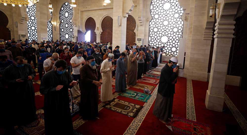 Palestinians hold Eid al-Fitr prayers amid coronavirus restrictions