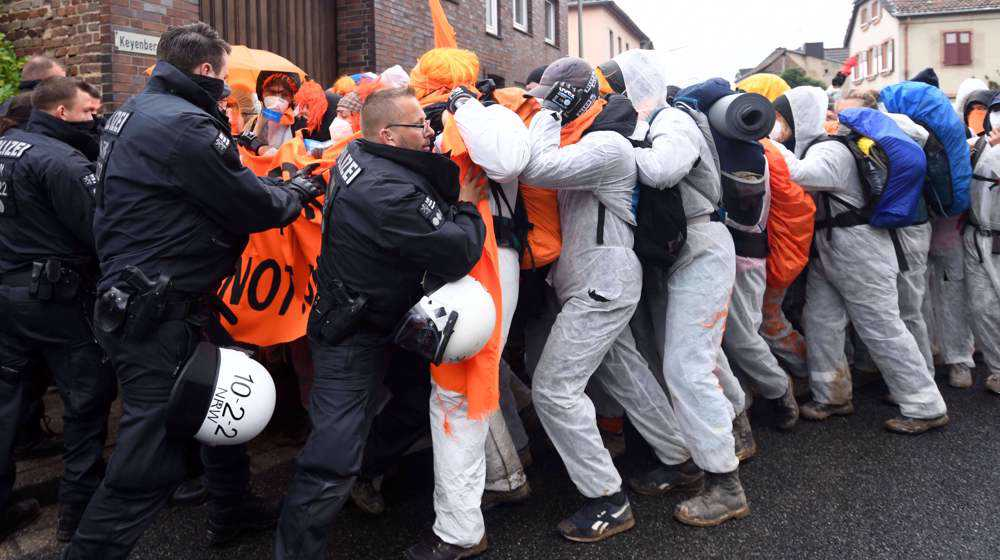 Climate activists protest at German coal mine, scuffle with police