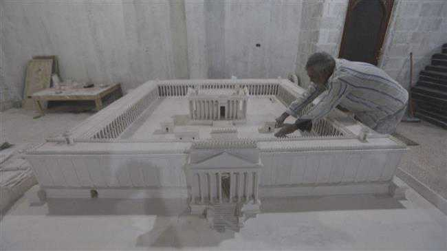 Molding plaster, displaced Syrian reconjures lost Palmyra ruins